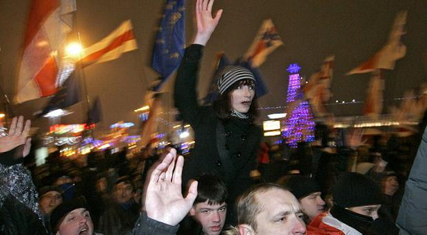 Opposition supporters shout slogans during a rally in Minsk, Belarus