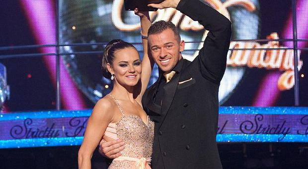 Kara Tointon has hinted at a blossoming romance with Artem Chigvintsev after winning the Strictly Come Dancing final