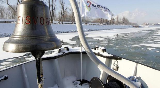 Ice-breaker Eisvogel clears the way for ships on the Danube River in the Vienna harbour (AP)