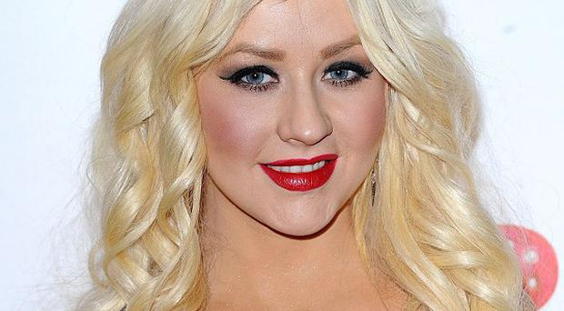 Ofcom is investigating complaints about Christina Aguilera's raunchy routine on the final of X Factor