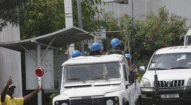 UN troops leave the UN headquarters that was attacked by gunmen, in Abidjan, Ivory Coast (AP)