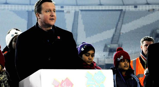 The Olympic Stadium floodlights are officially switched on by Prime Minister David Cameron