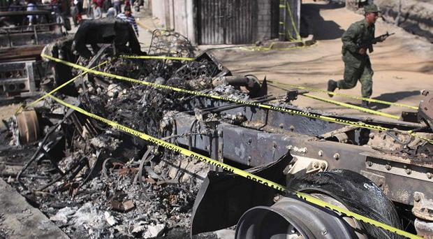 A truck destroyed in an oil pipeline explosion in San Martin Texmelucan, Mexico