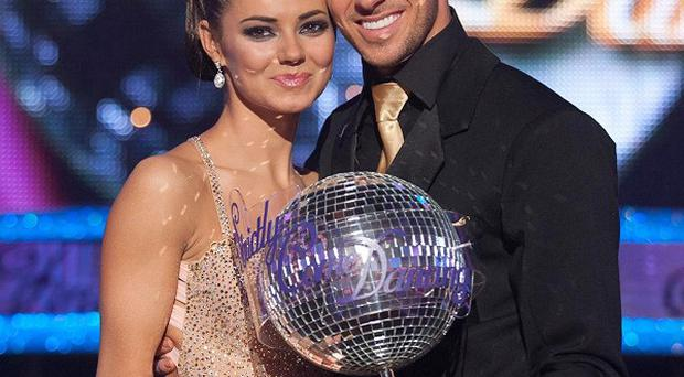 Kara Tointon lifted the Strictly glitterball trophy with partner Artem Chigvintsev