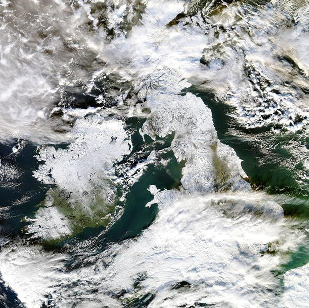 A satellite image of a snow covered UK taken from a NASA satellite