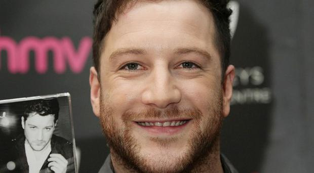The X Factor winner Matt Cardle has won the race for the Christmas number one single