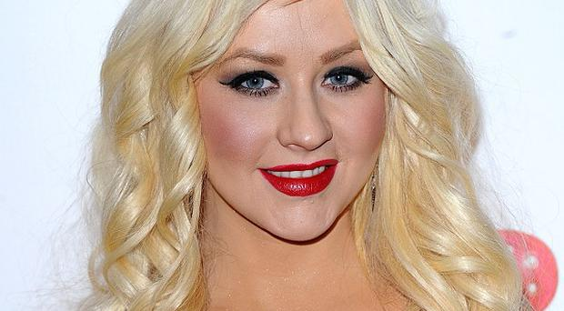 Christina Aguilera performed on the racy X Factor final being investigated by TV watchdogs