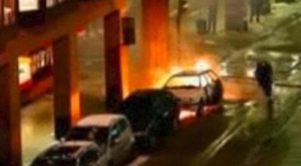 Emergency services attend the scene after a car exploded in Stockholm on December 1 (AP)