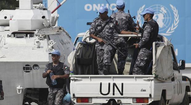 UN forces patrol outside their headqarters in the Ivory Coast (AP)