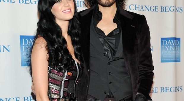 Katy Perry says one of the secret to keeping her marriage to Russell Brand interesting is 'never wearing sweats'
