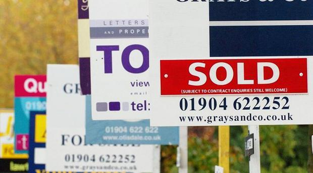 House prices look set to end 2011 two per cent lower than they started it, Rics said