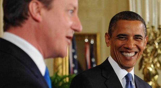 David Cameron and Barack Obama agreed their two nations are 'on the same page' on Afghanistan