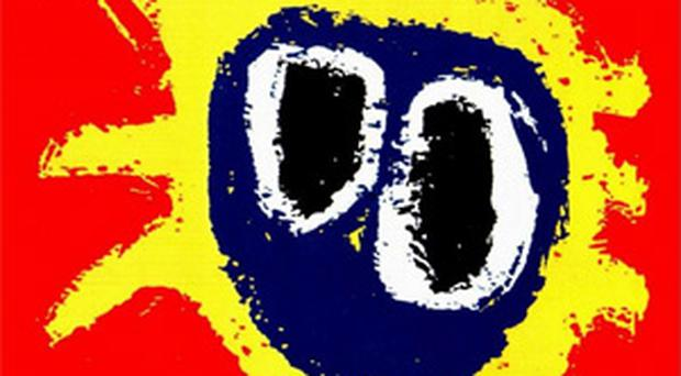 Tributes paid to former guitarist of Primal Scream. The cover of the band's Screamadelica album
