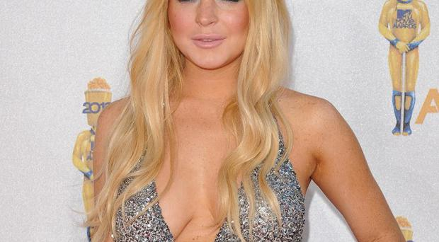 The Betty Ford Centre has sacked an employee who accused actress Lindsay Lohan of attacking her