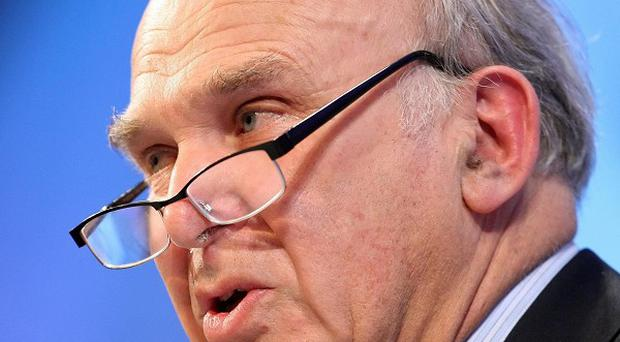 Vince Cable clinged on to his position in Government after being humiliatingly rebuked by the Prime Minister