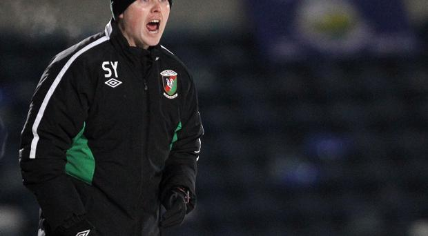 Glentoran boss Scott Young is willing to take on Linfield next Tuesday