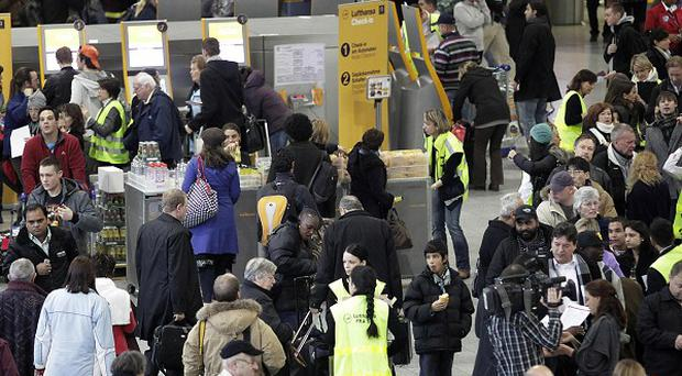 Frankfurt airport in chaos earlier this week, but the snow-induced travel crisis has now eased slightly (AP)