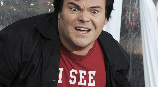 Jack Black says he tends to do what his wife wants