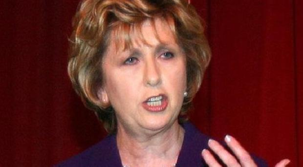 Controversial laws to reform the banks have been rubber stamped by President Mary McAleese