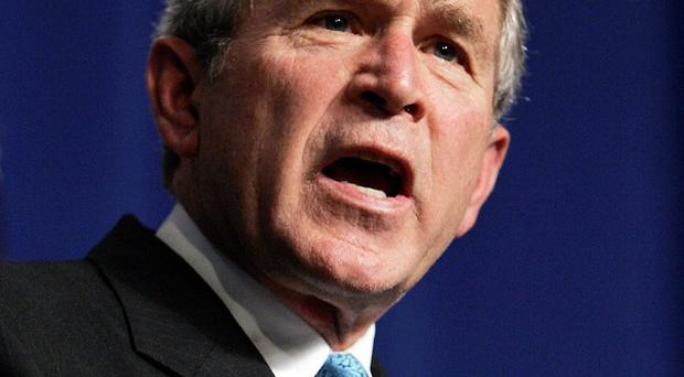 A driver crashed his car onto the lawn of former US president George W Bush