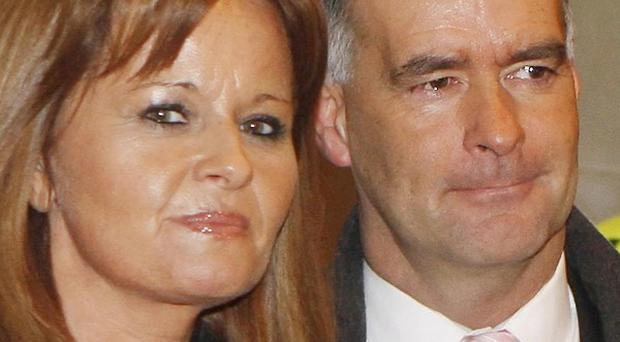 Tommy and Gail Sheridan leave court after he was found guilty of perjury