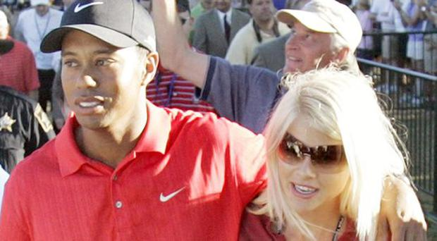 Tiger Woods with Elin Nordegren