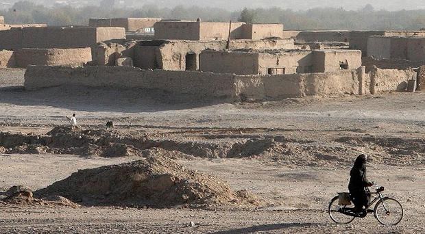 Two people have been killed in an air strike by a Nato helicopter in northern Afghanistan