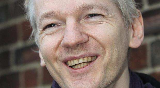 Julian Assange has said it would be 'politically impossible' for Britain to extradite him to the United States for espionage