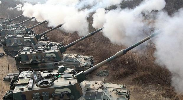 South Korea's army fires live rounds during an exercise in Pocheon, 20 miles from the border with the North (AP)