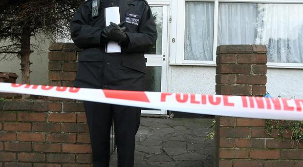 Police outside a property where Barbara Williams was mauled to death by a Belgian mastiff dog
