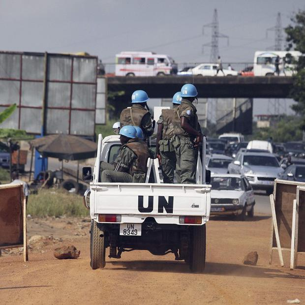 UN forces patrol a street of Abidjan, Ivory Coast (AP)