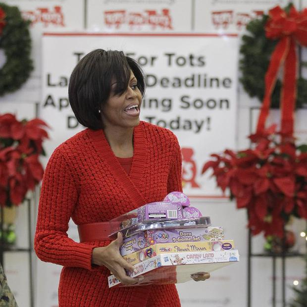 US first lady Michelle Obama fielded calls from awed children when she joined a Santa-tracking switchboard on Christmas Eve