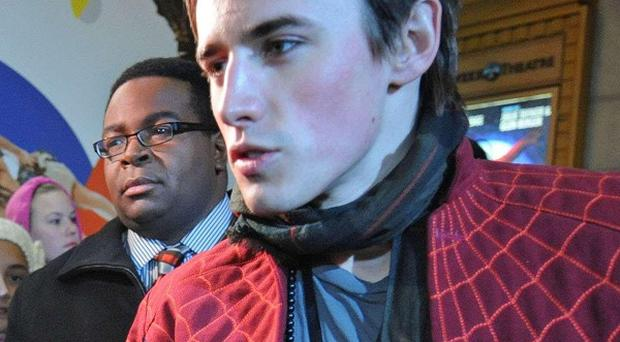 Reeve Carney who plays Spider-Man, hands out autographs outside the Foxwoods Theatre in Times Square, New York (AP)