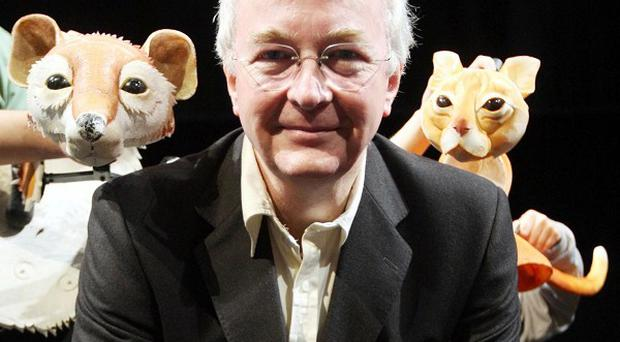 Novelist Philip Pullman condemned the decision to cut literacy scheme Booktrust's funding
