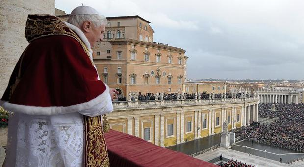 Pope Benedict XVI blesses the faithful during the Urbi et Orbi message in St Peter's Square at the Vatican