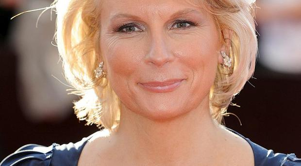 Comedian Jennifer Saunders made light of her cancer treatment as she spoke about her illness for the first time