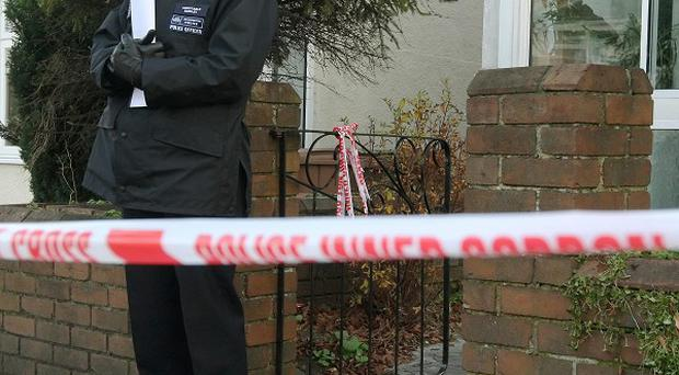 Police outside a property in Demesne Road in Wallington where 52-year-old Barbara Williams was mauled to death by a Belgian mastiff