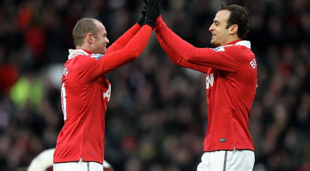 MANCHESTER, ENGLAND - DECEMBER 26: Dimitar Berbatov of Manchester United celebrates scoring the opening goal with team mate Wayne Rooney (L) during the Barclays Premier League match between Manchester United and Sunderland at Old Trafford on December 26, 2010 in Manchester, England. (Photo by Ian Walton/Getty Images)