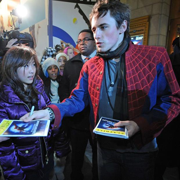 Spider-Man star Reeve Carney signs autographs outside the Foxwoods Theatre in Times Square, New York (AP)