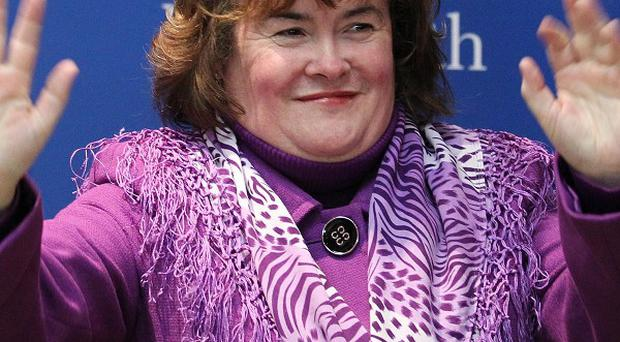 Susan Boyle was beaten to the US number one slot by Taylor Swift