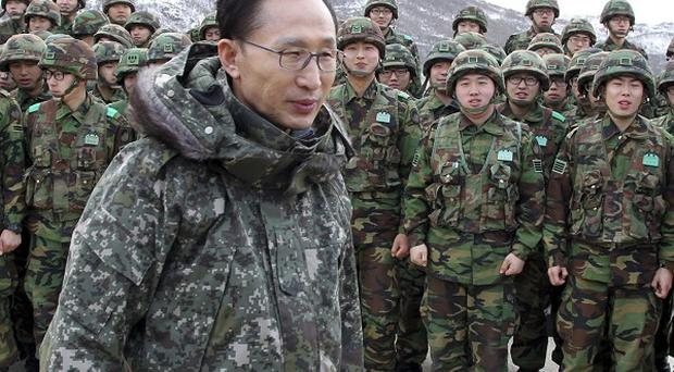 South Korean President Lee Myung-bak has told the North his country is not afraid of war (AP)