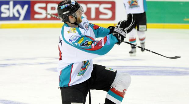 Tim Cook celebrated a crucial strike for the Belfast Giants in Glasgow last night