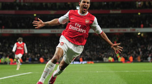 Theo Walcott of Arsenal celebrates Arsenal's third goal during the Barclays Premier League match between Arsenal and Chelsea at the Emirates Stadium on December 27, 2010 in London, England.