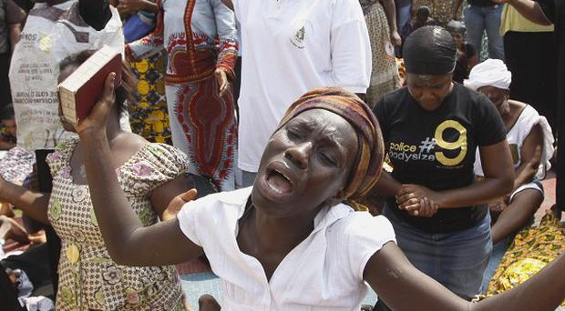 Women from Ivory Coast's Woman Christian Association pray for peace in Abidjan (AP)