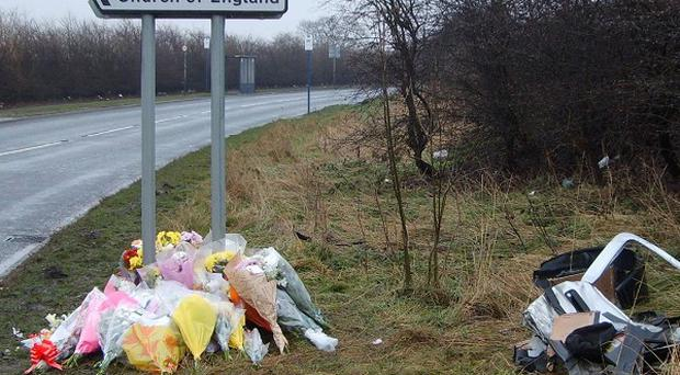 Flowers have been laid at the scene in Mexborough, where three teenagers were killed in a car crash.