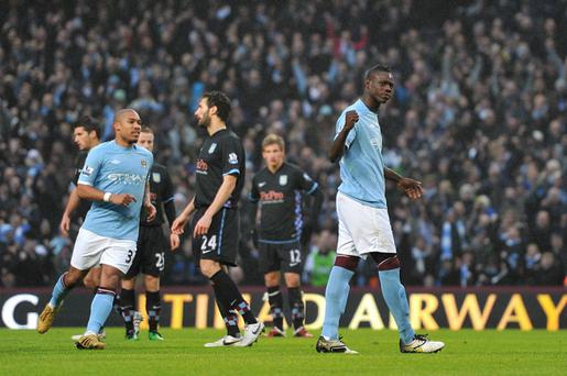 Manchester City's Mario Balotelli (right) celebrates scoring his side's first goal of the game from the penalty spot during the Barclays Premier League match at the City of Manchester Stadium, Manchester.