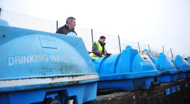 Pacemaker Press 28/12/10 Bowsers are filled up outside Westland House in North Belfast after homes across Belfast run out, They will be brought to 5 sites across Belfast so people can get water Pic Colm Lenaghan/Pacemaker