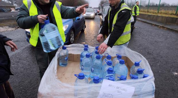 Presseye.com - Belfast - Northern Ireland - 28th December 2010. Picture by Matt Mackey/Presseye.com - Belfast.General views from NI Waters Westland base as members of the public come to pick up bottles of water.