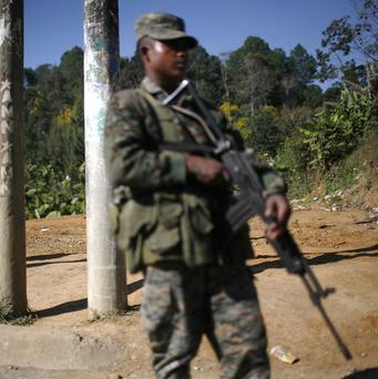 A soldier stands guard at a checkpoint in Coban, Guatemala (AP)