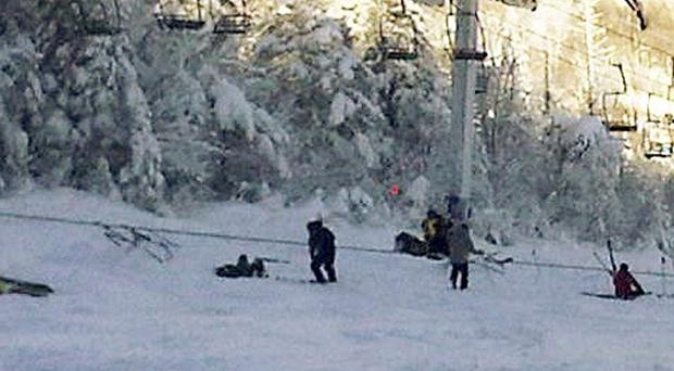Skiers and lift chairs lie on the slope after a lift derailed on a mountain in Carrabassett Valley, Maine (AP)